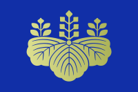 Japanese prime minister's coat of arm with stylized leaf of paulownia.